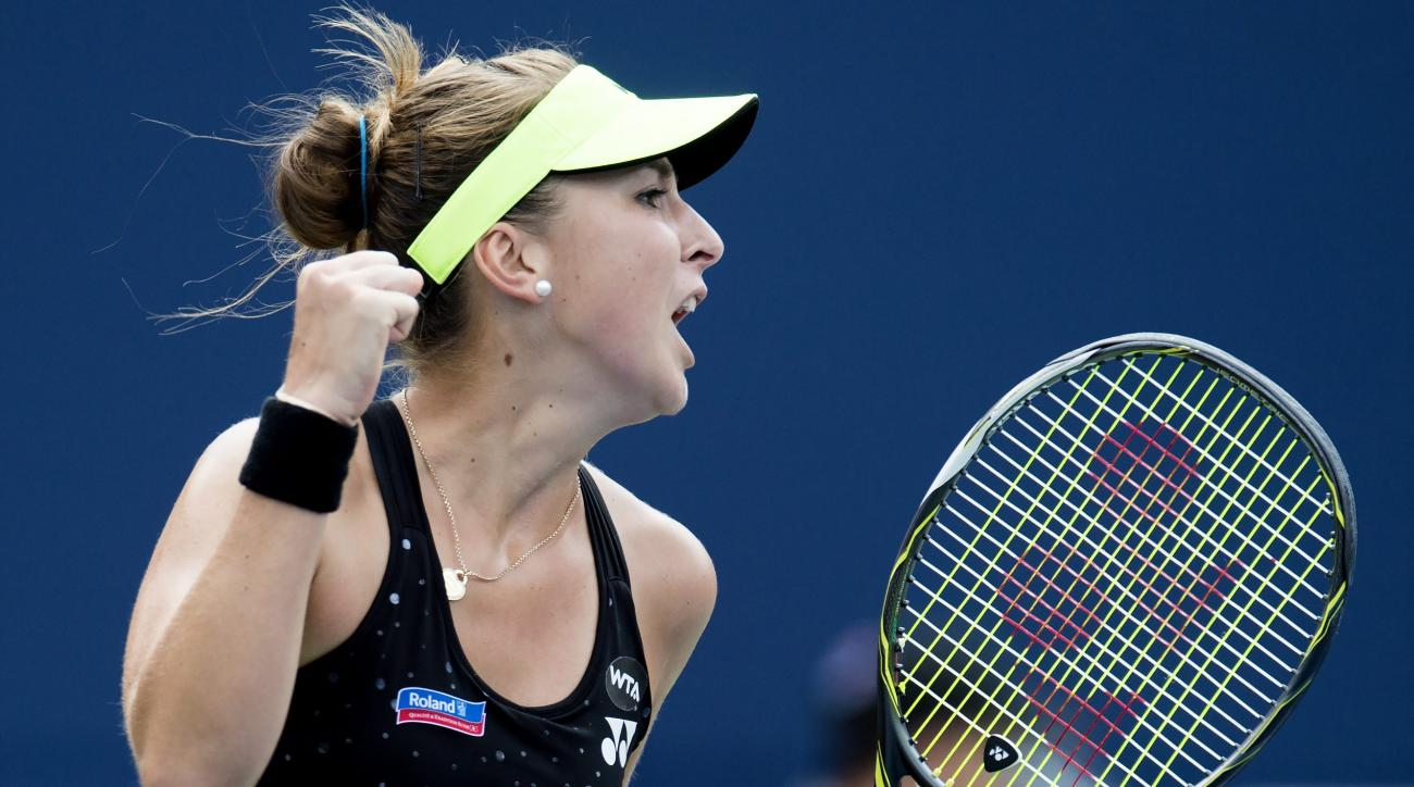 Belinda Bencic, of Switzerland, celebrates after winning the first set against Simona Halep, of Romania,  during the women's final at the Rogers Cup tennis tournament in Toronto, Sunday, Aug. 16, 2015. (Frank Gunn/The Canadian Press via AP)