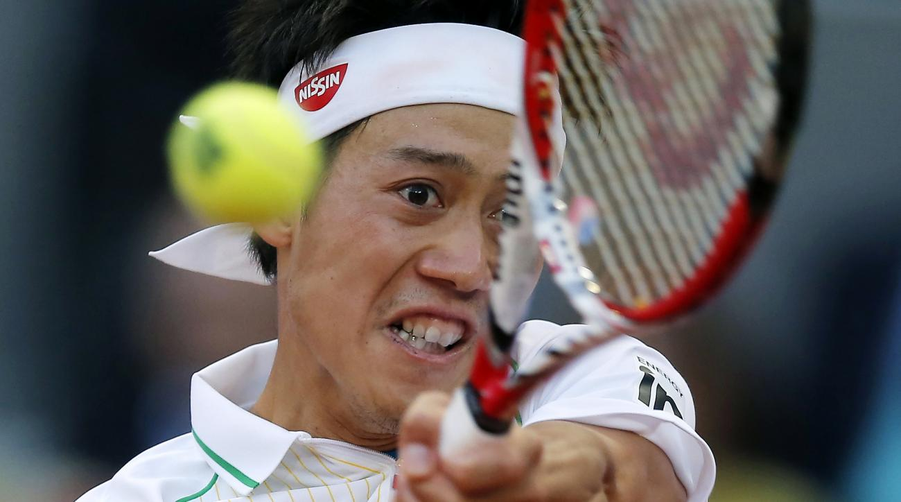 FILE - In this May 11, 2014, file photo, Kei Nishikori. from Japan. returns the ball against Rafael Nadal from Spain, during the final of the Madrid Open tennis tournament in Madrid, Spain. Nishikori will participate in a sports and entertainment event ho