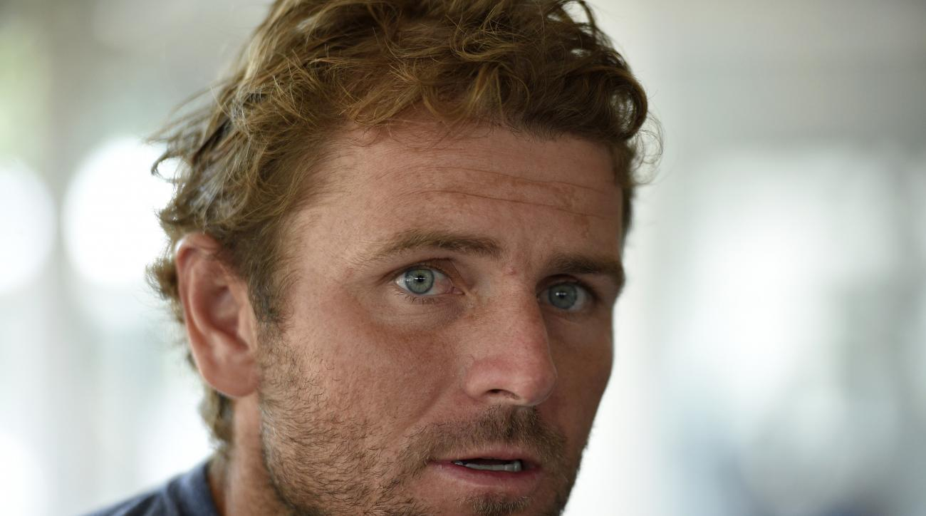 FILE - In this Aug. 4, 2015, file photo, Mardy Fish speaks during an interview at the Citi Open tennis tournament in Washington. Fish, a former top-10 player, plans to bring things full circle, in a way, by playing in the U.S. Open, which begins Monday. I
