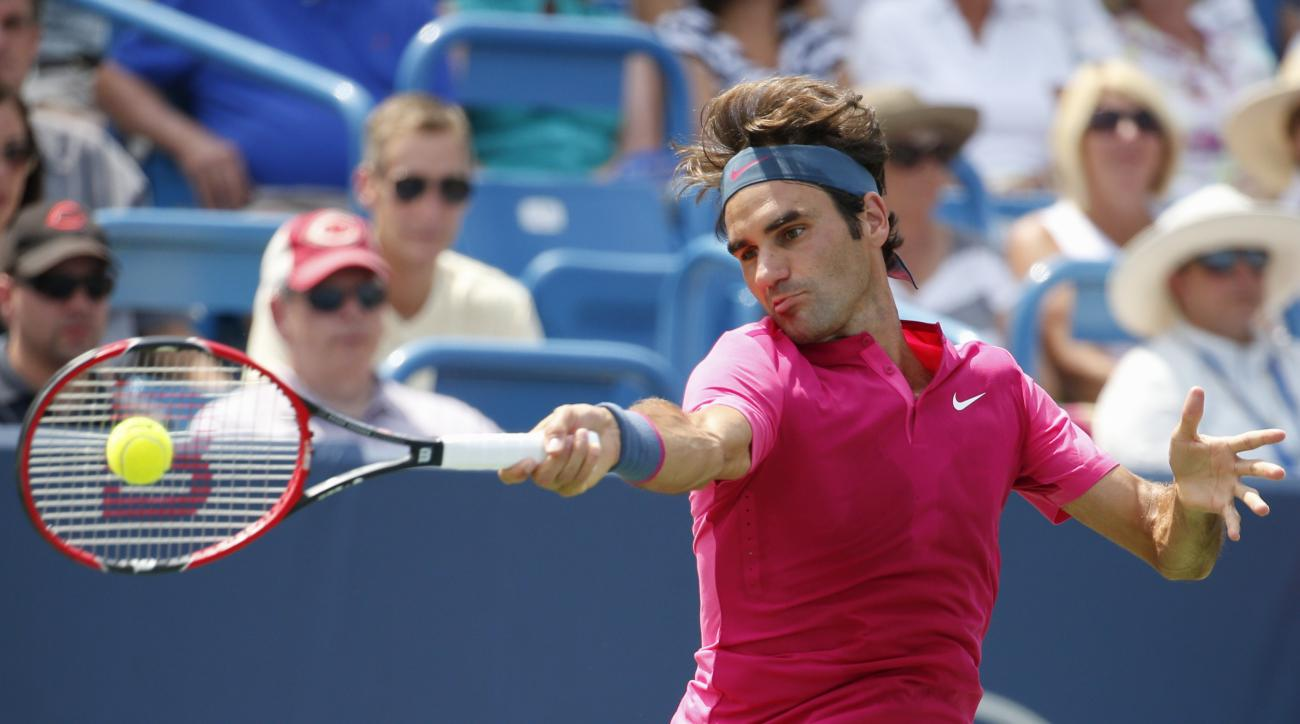 ADVANCE FOR WEEKEND EDITIONS, AUG. 29-30 - FILE -  In this Aug. 23, 2015, file photo, Roger Federer, of Switzerland, returns the ball to Novak Djokovic, of Serbia, during a final match at the Western & Southern Open tennis tournament in Mason, Ohio. Djoko