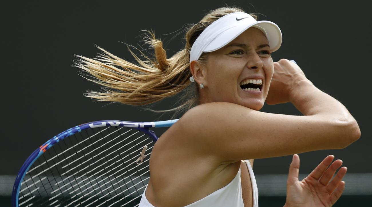 ADVANCE FOR WEEKEND EDITIONS, AUG. 29-30  - FILE - In this July 3, 2015, file photo, Maria Sharapova returns a ball to Irina-Camelia Begu during their singles match at the All England Lawn Tennis Championships in Wimbledon, London. Sharapova is seeded thi