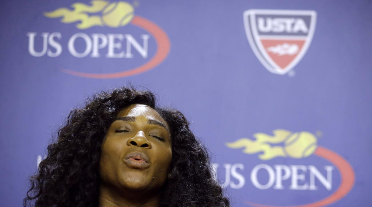U.S. Open tennis defending champion Serena Williams gestures during a press conference at the USTA Billie Jean King National Tennis Center in New York, Thursday, Aug. 27, 2015.  Williams is in position to win a Grand Slam this year if she wins the U.S. Op