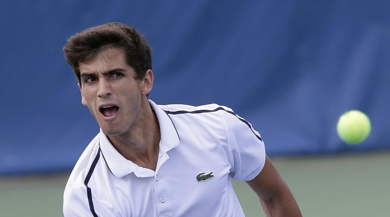 Pierre-Hugues Herbert, of France, returns a shot from Steve Johnson during a semifinal at the Winston-Salem Open tennis tournament in Winston-Salem, N.C., Friday, Aug. 28, 2015. (AP Photo/Gerry Broome)