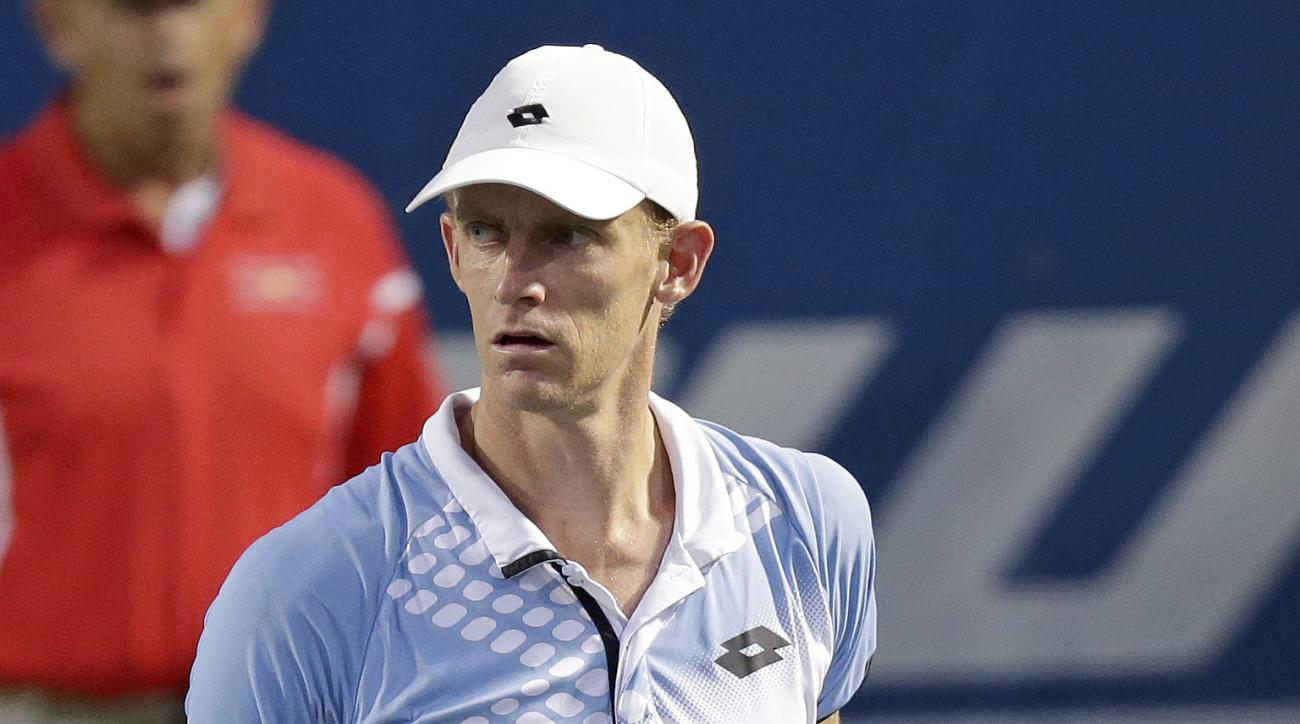 Kevin Anderson, of South Africa, pumps his fist during a semifinal against Malek Jaziri, of Tunisia, at the Winston-Salem Open tennis tournament in Winston-Salem, N.C., Friday, Aug. 28, 2015. (AP Photo/Gerry Broome)