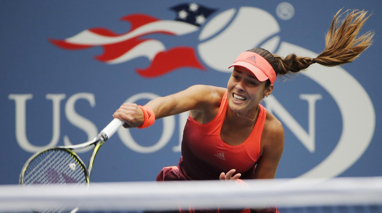 Ana Ivanovic, of Serbia, serves against Dominika Cibulkova, of Slovakia, during the first round of the U.S. Open tennis tournament, Monday, Aug. 31, 2015, in New York. (AP Photo/Matt Rourke)