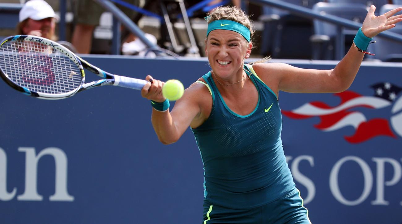 Victoria Azarenka, of Belarus, returns to Lucie Hradecka, of the Czech Republic, during the first round of the U.S. Open tennis tournament, Tuesday, Sept. 1, 2015, in New York. (AP Photo/Adam Hunger)