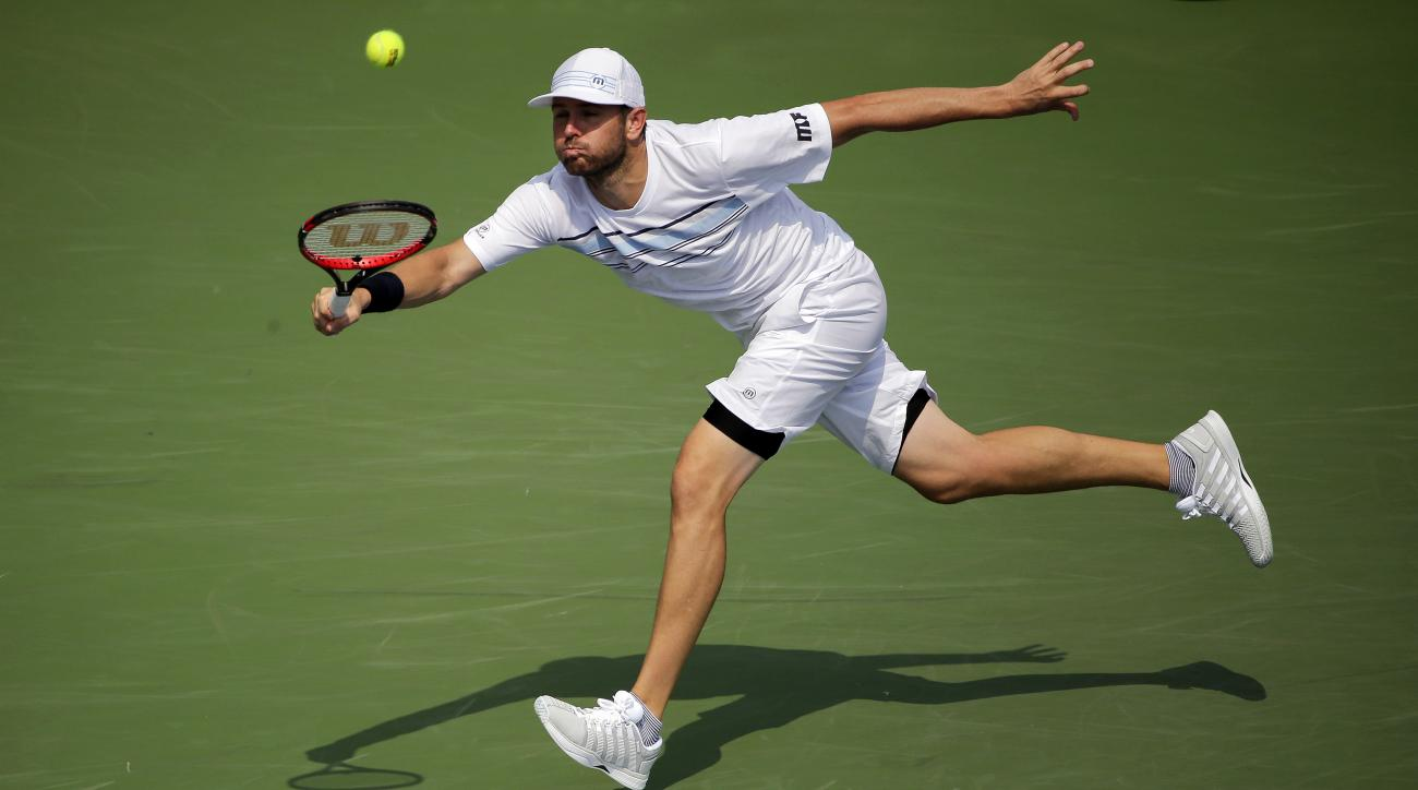 Mardy Fish returns a shot to Feliciano Lopez, of Spain, during the second round of the U.S. Open tennis tournament, Wednesday, Sept. 2, 2015, in New York. (AP Photo/Frank Franklin II)