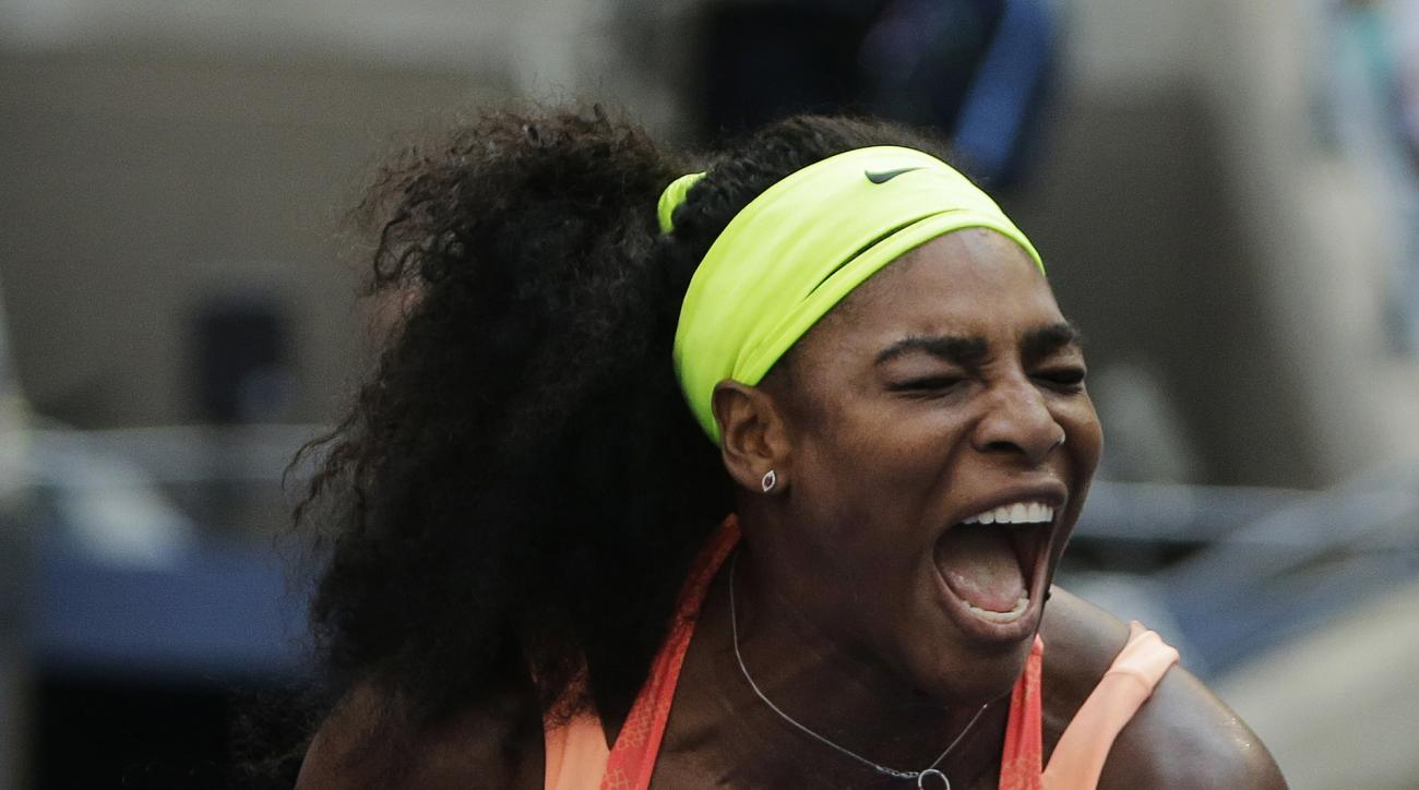 Serena Williams reacts after winning a point against Kiki Bertens, of the Netherlands, during the second round of the U.S. Open tennis tournament, Wednesday, Sept. 2, 2015, in New York. (AP Photo/Charles Krupa)