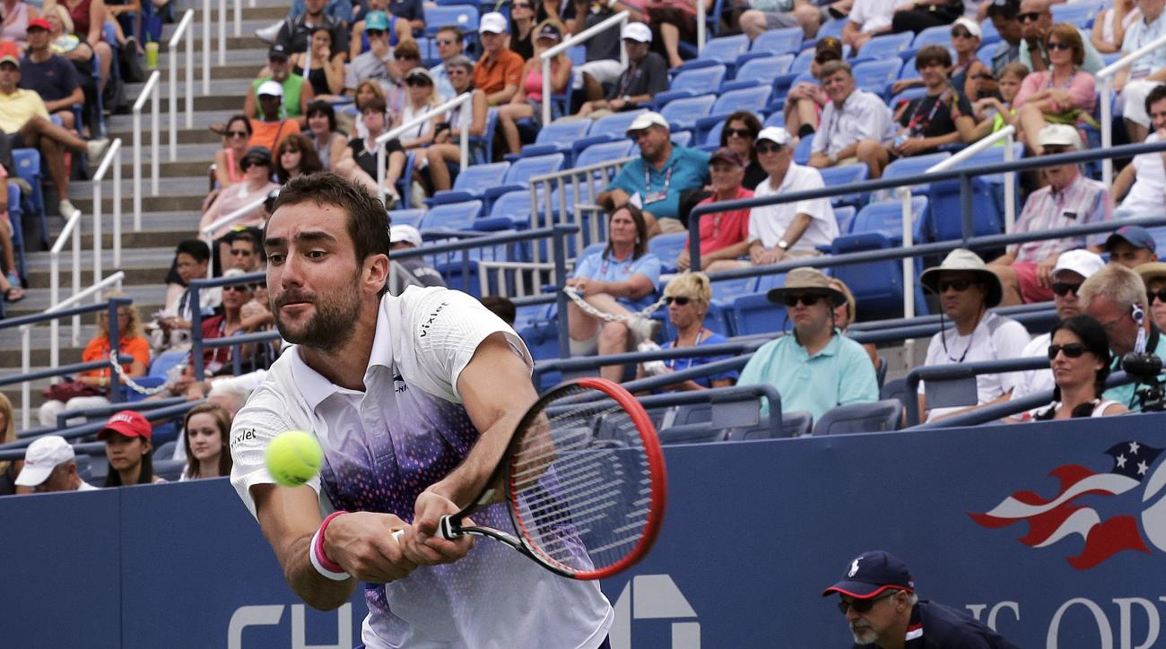 Marin Cilic, of Croatia, returns a shot to Mikhail Kukushkin, of Kazakhstan, during the third round of the U.S. Open tennis tournament, Friday, Sept. 4, 2015, in New York. (AP Photo/Charles Krupa)