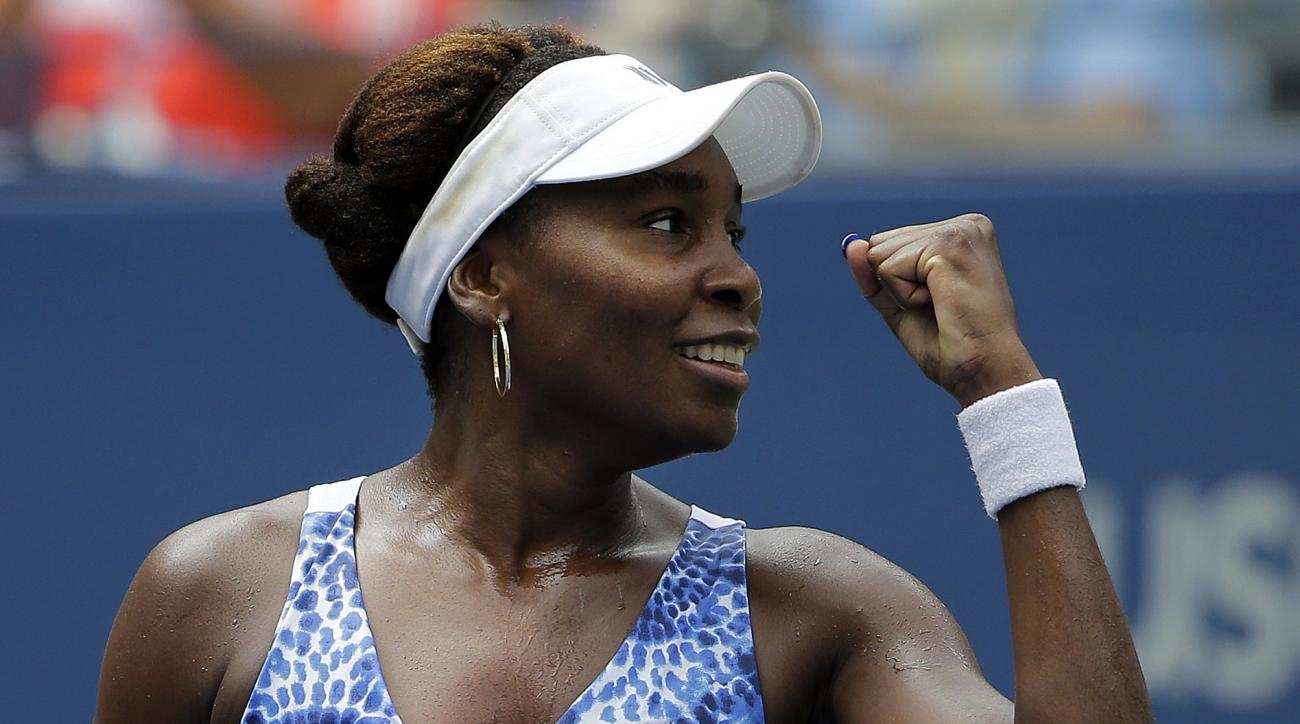 Venus Williams, of the United States, reacts to her coach's box after defeating Belinda Bencic, of Switzerland, during the third round of the U.S. Open tennis tournament, Friday, Sept. 4, 2015, in New York. (AP Photo/Matt Rourke)