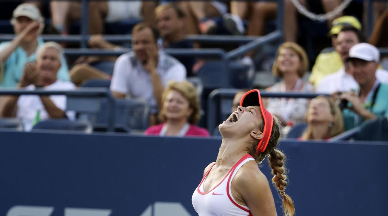 Eugenie Bouchard, of Canada, reacts after defeating Dominika Cibulkova, of Slovakia, during the third round of the U.S. Open tennis tournament, Friday, Sept. 4, 2015, in New York. (AP Photo/Charles Krupa)