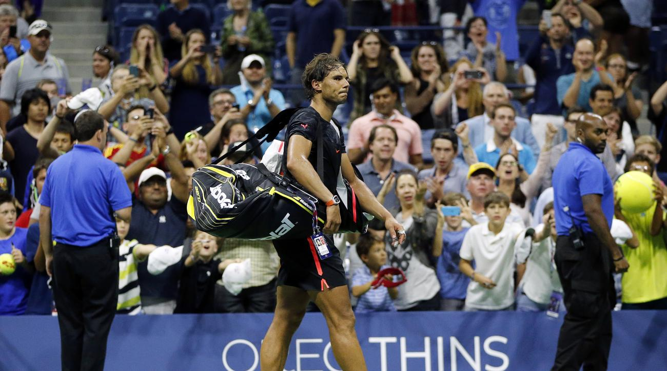 Rafael Nadal, of Spain, leaves the court after losing to Fabio Fognini, of Italy, during the U.S. Open tennis tournament in New York, Saturday, Sept. 5, 2015. (AP Photo/Julio Cortez)