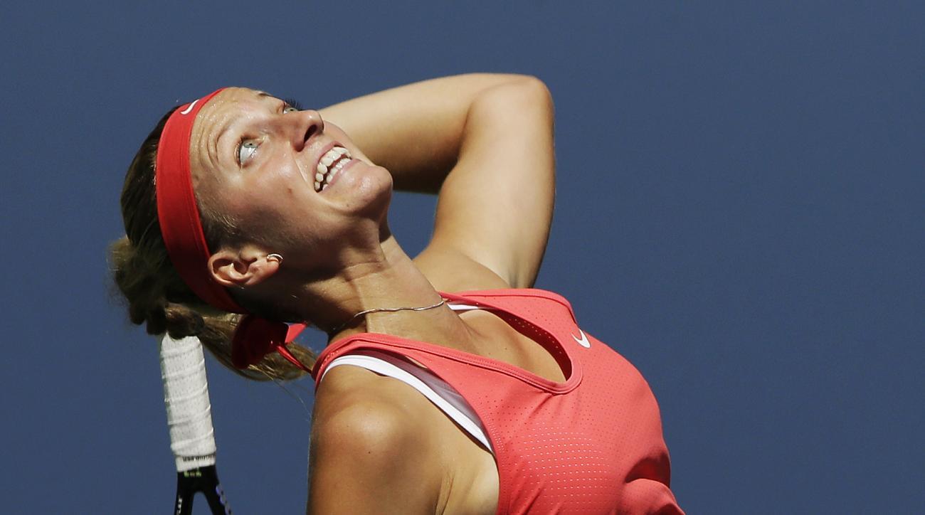 Petra Kvitova, of the Czech Republic, serves to Anna Karolina Schmiedlova, of Slovakia, during the third round of the U.S. Open tennis tournament, Saturday, Sept. 5, 2015, in New York. (AP Photo/Charles Krupa)