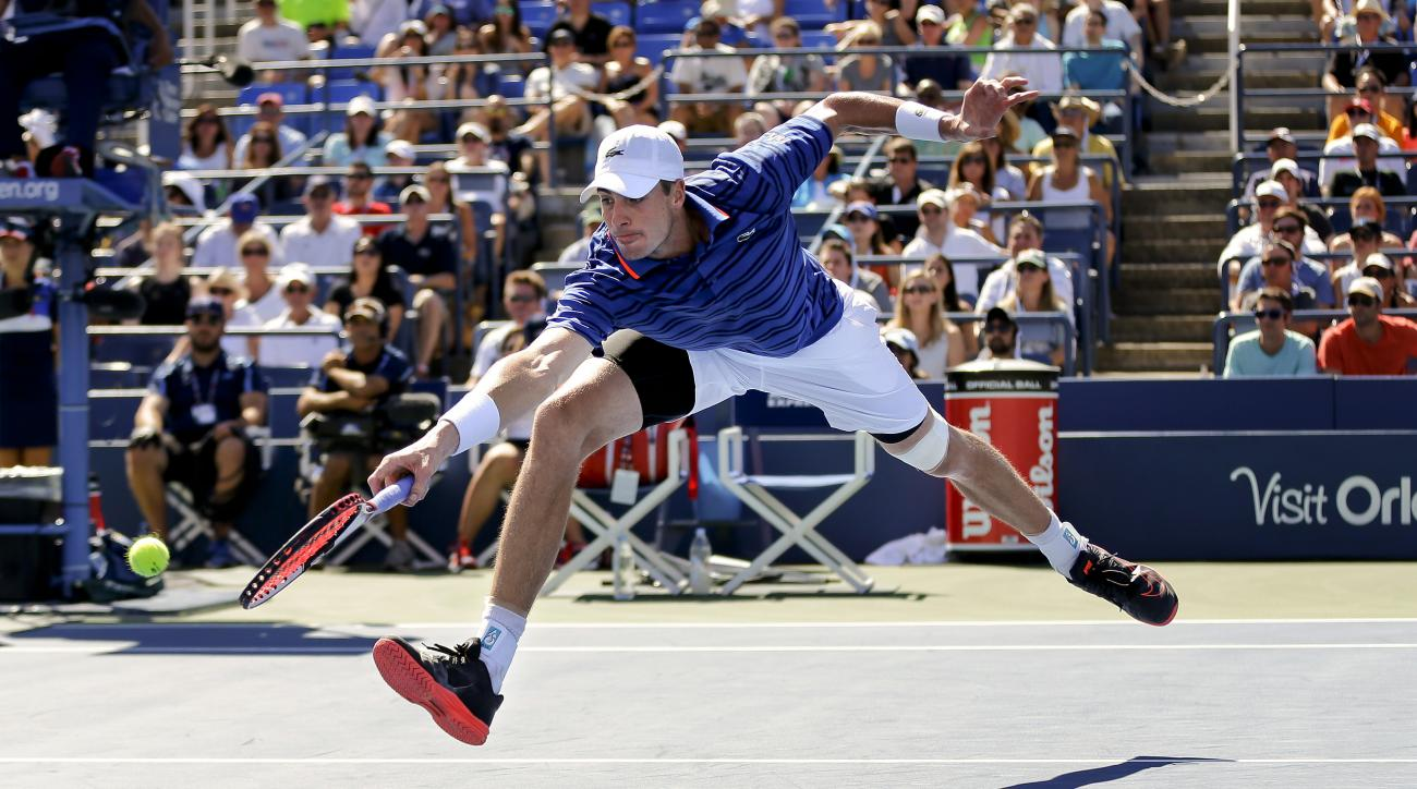 John Isner, of the United States, returns a shot to Jiri Vesely, of the Czech Republic, during the third round of the U.S. Open tennis tournament, Saturday, Sept. 5, 2015, in New York. (AP Photo/Matt Rourke)