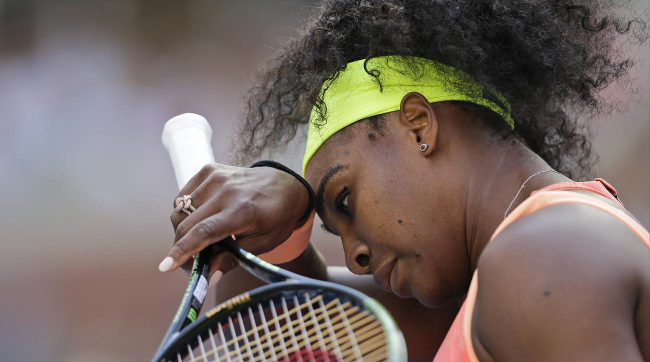 Serena Williams, of the United States, wipes her brow during her match with Madison Keys, of the United States, during the fourth round of the U.S. Open tennis tournament, Sunday, Sept. 6, 2015, in New York. (AP Photo/Charles Krupa)