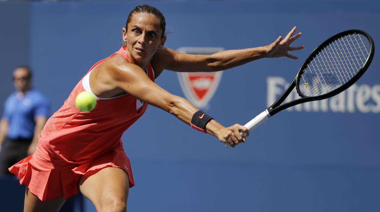 oRoberta Vinci, of Italy, returns a shot to Kristina Mladenovic, of France, during a quarterfinal match at the U.S. Open tennis tournament, Tuesday, Sept. 8, 2015, in New York. (AP Photo/David Goldman)