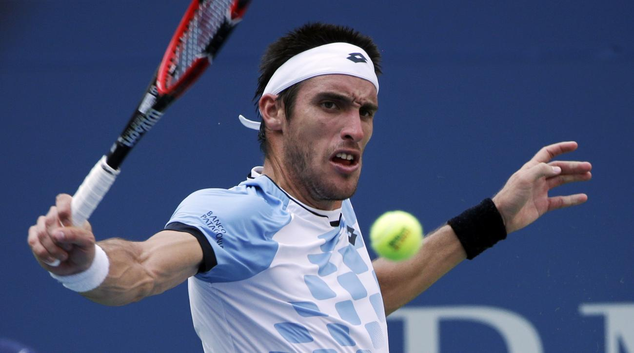 FILE - In this Sept. 1, 2015 file photo, Leonardo Mayer, of Argentina, returns to Roger Federer, of Switzerland, during the first round of the U.S. Open tennis tournament, in New York. Argentina travels in September to Belgium, which defeated Canada 3-0 t