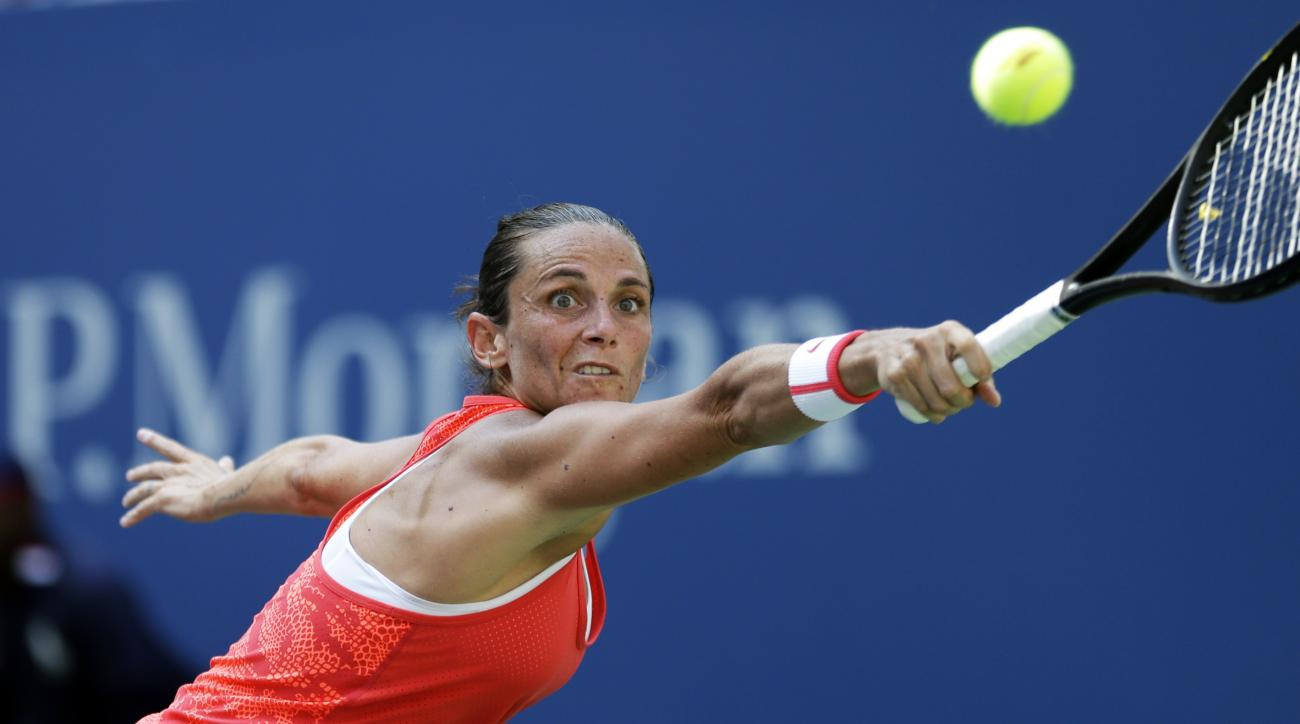 Roberta Vinci, of Italy, returns a shot to Kristina Mladenovic, of France, during a quarterfinal match at the U.S. Open tennis tournament, Tuesday, Sept. 8, 2015, in New York. (AP Photo/David Goldman)