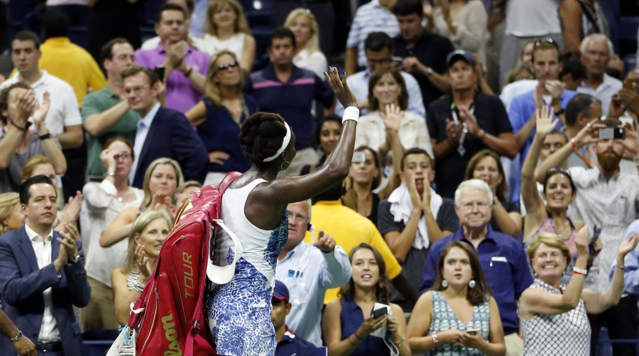 Venus Williams waves to the crowd after losing to Serena Williams during a quarterfinal match at the U.S. Open tennis tournament, Tuesday, Sept. 8, 2015, in New York. (AP Photo/Julio Cortez)