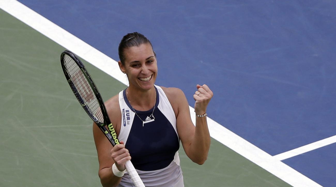 Flavia Pennetta, of Italy, reacts after beating Petra Kvitova, of the Czech Republic, during a quarterfinal match at the U.S. Open tennis tournament, Wednesday, Sept. 9, 2015, in New York. (AP Photo/Seth Wenig)