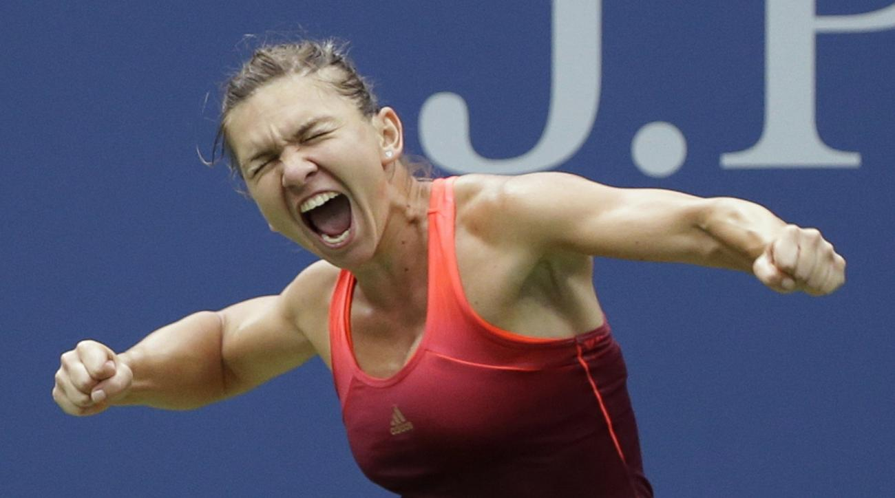 Simona Halep, of Romania, reacts after beating Victoria Azarenka, of Belarus, during a quarterfinal match at the U.S. Open tennis tournament, Wednesday, Sept. 9, 2015, in New York. (AP Photo/Seth Wenig)