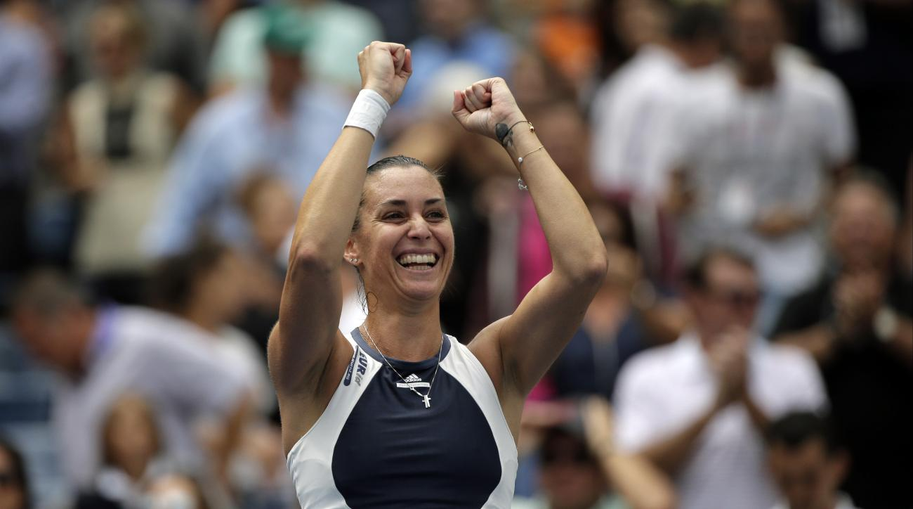 Flavia Pennetta, of Italy, reacts after winning a semifinal match against Simona Halep, of Romania, at the U.S. Open tennis tournament, Friday, Sept. 11, 2015, in New York. (AP Photo/Bill Kostroun)