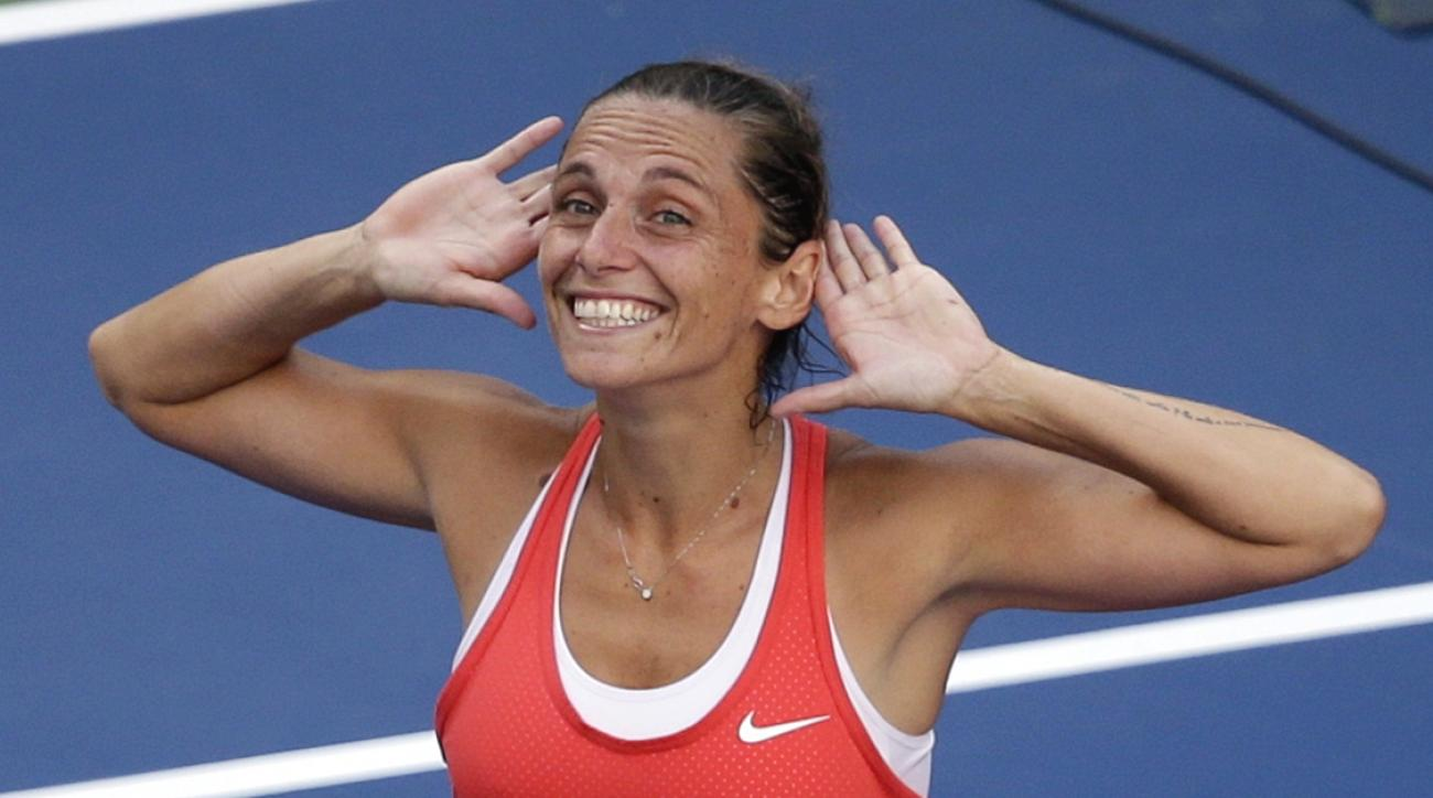 Roberta Vinci, of Italy, reacts to the crowd after beating Serena Williams during a semifinal match at the U.S. Open tennis tournament, Friday, Sept. 11, 2015, in New York. (AP Photo/Seth Wenig)