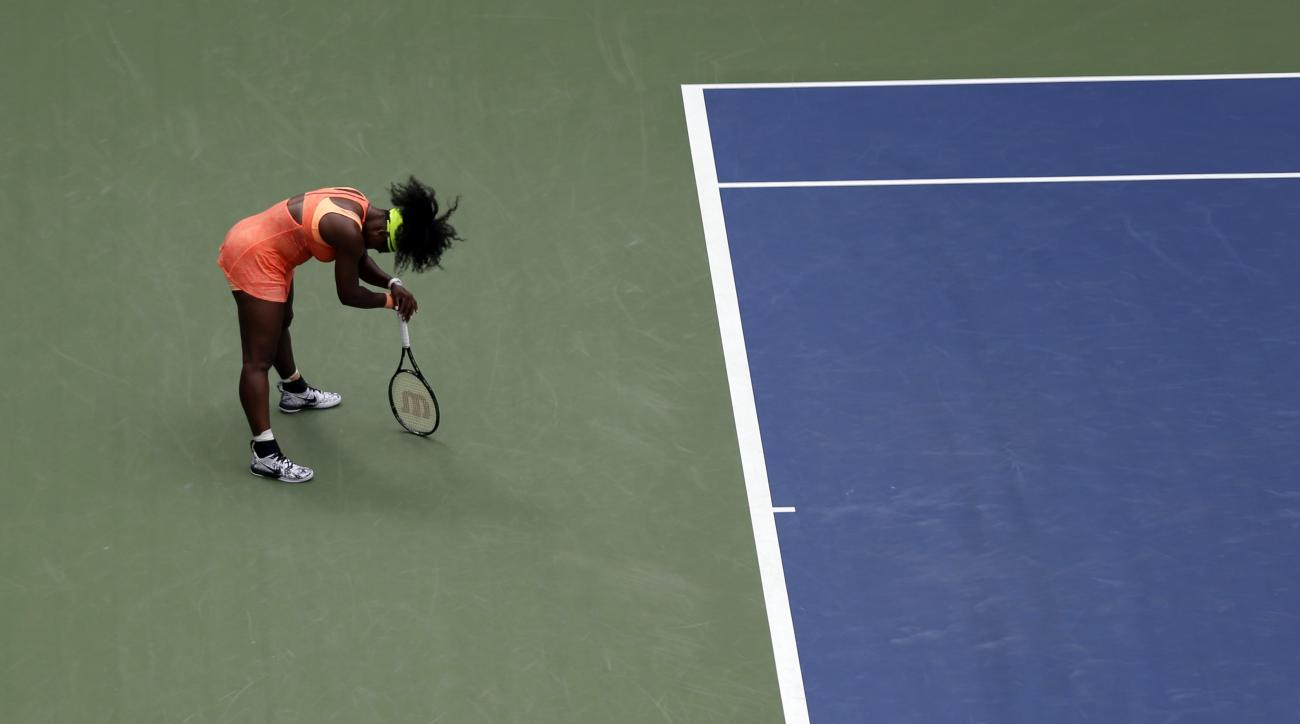 Serena Williams reacts after losing a point to Roberta Vinci, of Italy, during a semifinal match at the U.S. Open tennis tournament, Friday, Sept. 11, 2015, in New York. (AP Photo/Seth Wenig)