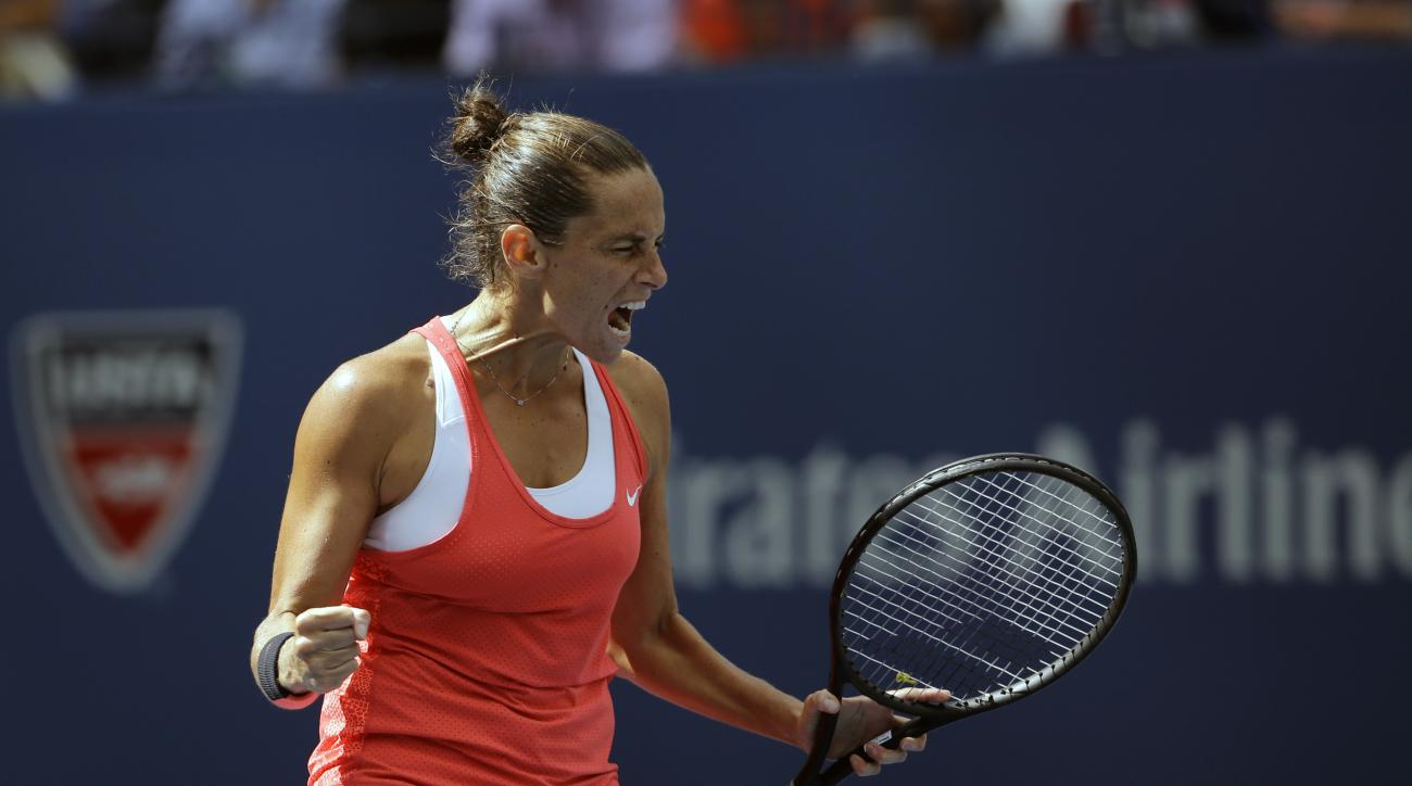 Roberta Vinci, of Italy, reacts after winning a point against Serena Williams during a semifinal match at the U.S. Open tennis tournament, Friday, Sept. 11, 2015, in New York. (AP Photo/David Goldman)