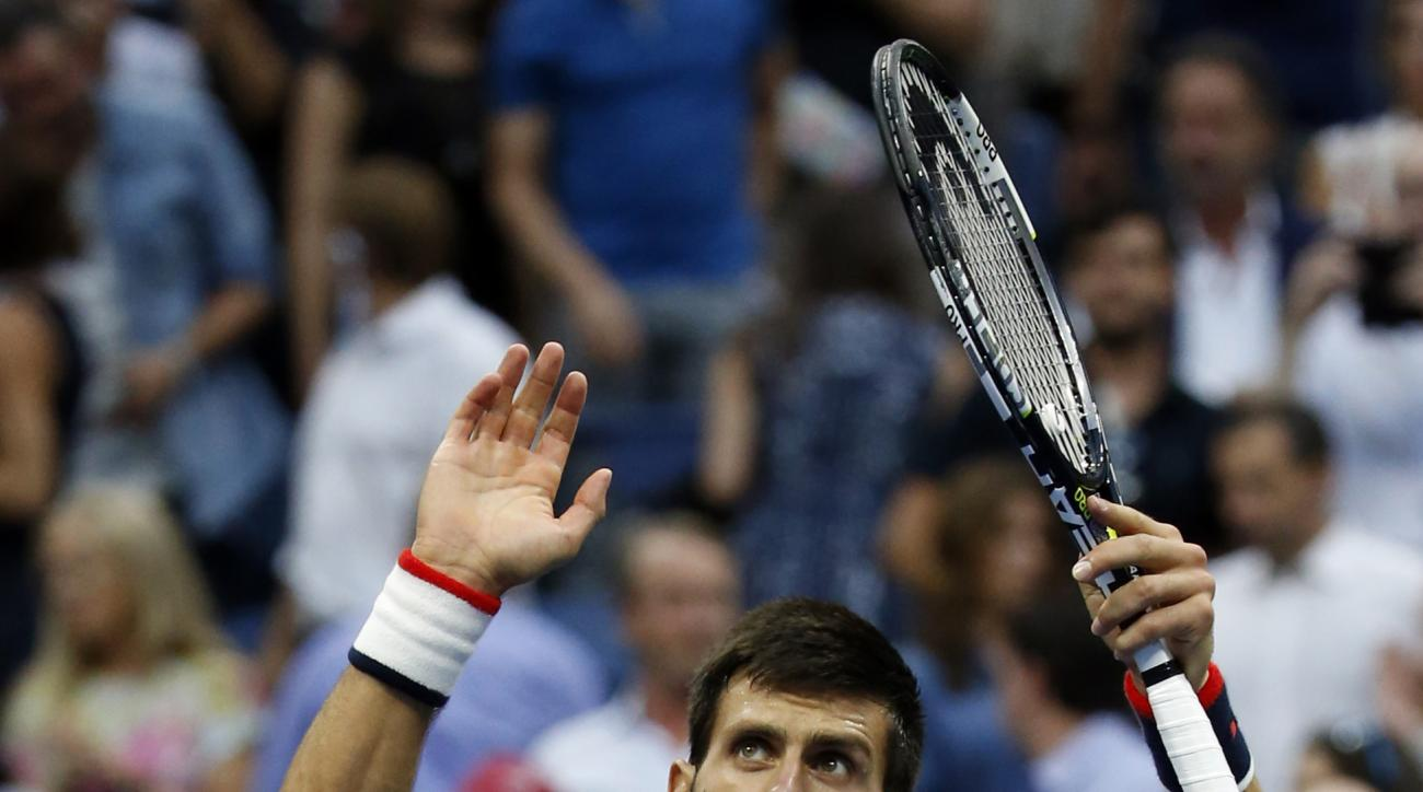 Novak Djokovic, of Serbia, waves to the crowd after beating Marin Cilic, of Croatia, during a semifinal match at the U.S. Open tennis tournament, Friday, Sept. 11, 2015, in New York. (AP Photo/Julio Cortez)