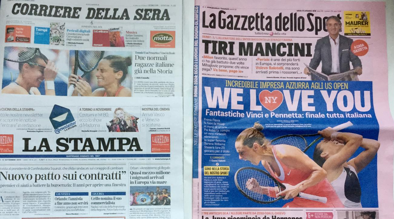 The front pages of the main Italian newspapers display pictures of Italian Tennis players Falvia Pennetta and Roberta Vinci, in Rome, Saturday, Sept. 12 ,2015. Compatriots Pennetta and Vinci are scheduled to play Saturday the U.S. Open Tennis final in New