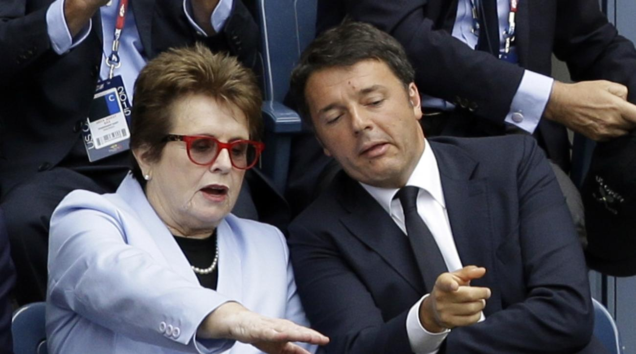 Former tennis champion Billie Jean King, left, sits with Italian Prime Minister Matteo Renzi during the women's championship match between Italians Flavia Pennetta and Roberta Vinci at the U.S. Open tennis tournament, Saturday, Sept. 12, 2015, in New York