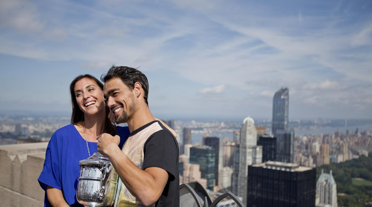 Flavia Pennetta, of Italy, left, poses with her fiance and fellow tennis player Fabio Fognini with the U.S. Open tennis women's singles championship trophy during a visit to the Top of the Rock Observation Deck at Rockefeller Center, Sunday, Sept. 13, 201