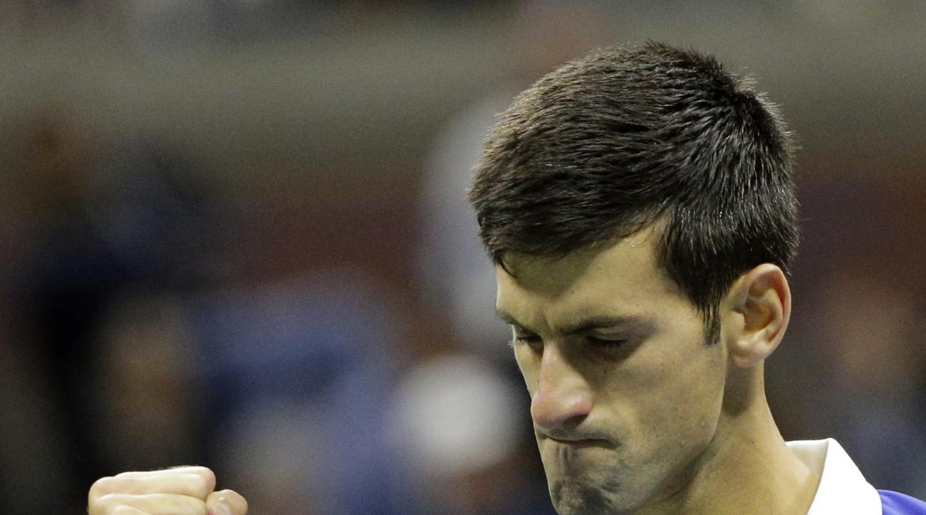 Novak Djokovic, of Serbia, clenches his fist while playing Roger Federer, of Switzerland, during the men's championship match of the U.S. Open tennis tournament, Sunday, Sept. 13, 2015, in New York. (AP Photo/Bill Kostroun)