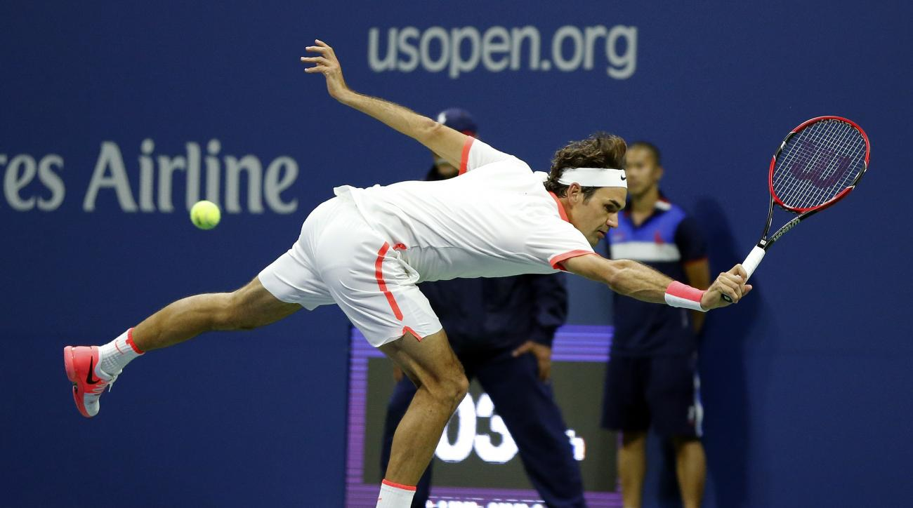 Roger Federer, of Switzerland, returns a shot to Novak Djokovic, of Serbia, during the men's championship match of the U.S. Open tennis tournament, Sunday, Sept. 13, 2015, in New York. (AP Photo/Julio Cortez)