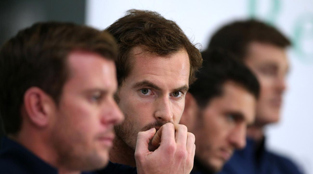 Britain's tennis star  Andy Murray, centre, looks on during press conference in Glasgow Scotland Wednesday Sept. 16, 2015. Britain play Australia in a Davis Cup semifinal starting on Friday. (Andrew Milligan/PA via AP) UNITED KINGDOM OUT  NO SALES NO ARCH