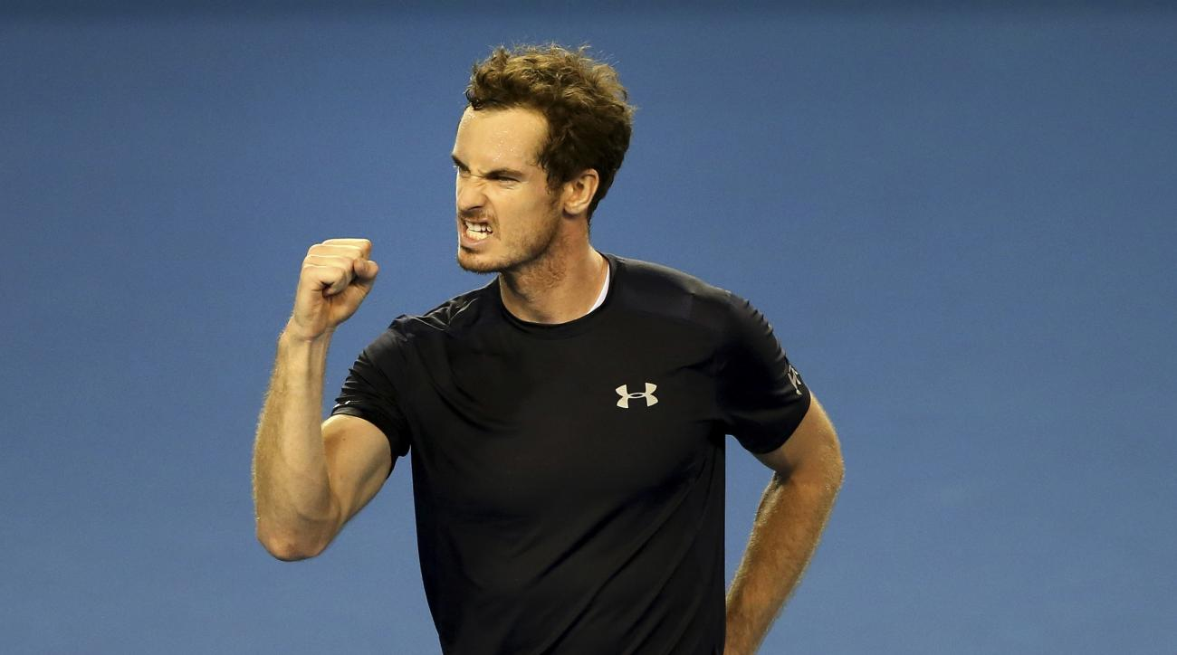 Britain's Andy Murray celebrates after winning semifinal tennis singles match of the Davis Cup againsr Australia's Thanasi Kokkinakis  in Glasgow, Scotland Friday Sept. 18, 2015. (AP Photo/Scott Heppell)