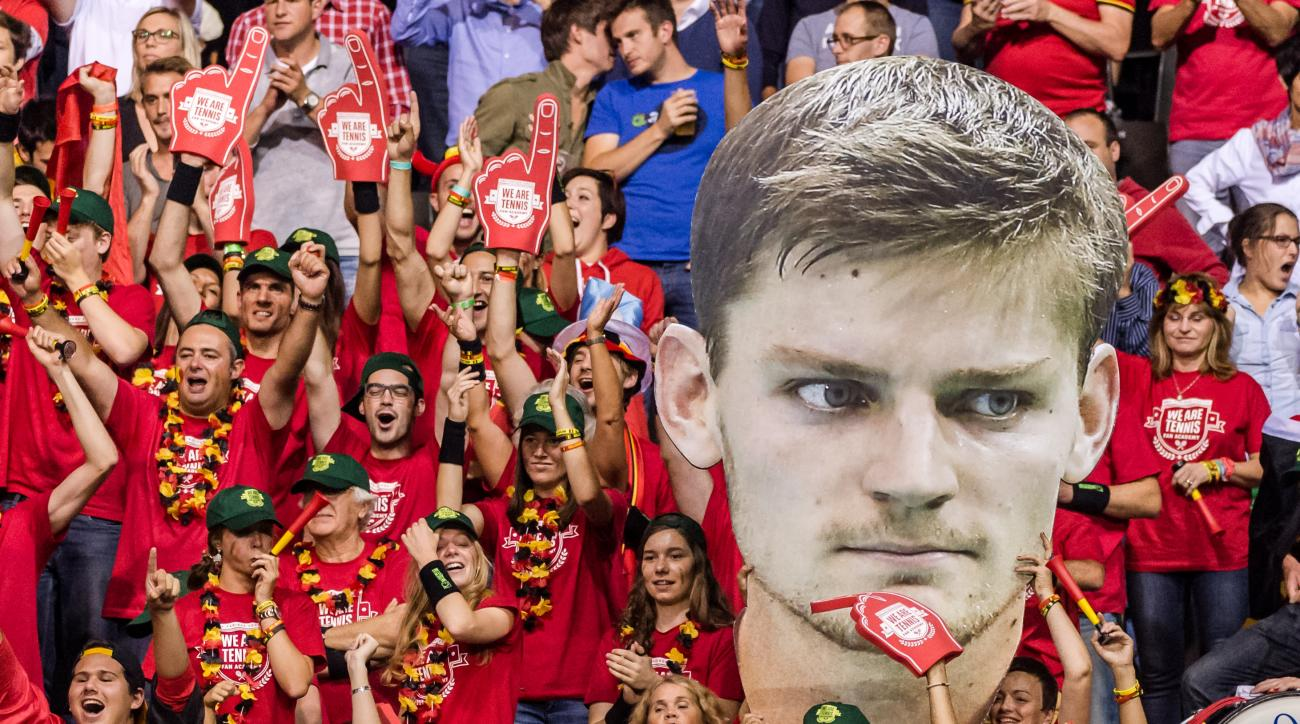 Belgian Davis Cup supporters hold a cardboard face of Belgium's ?David Goffin after he won the first singles match against Argentina's Federico Delbonis during the Davis Cup World Group semifinal between Belgium and Argentina in Brussels, Friday, Sept. 18