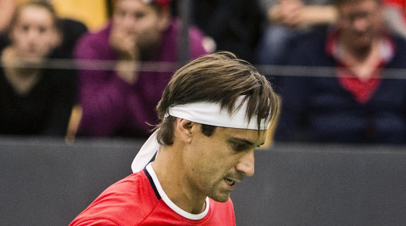 David Ferrer of Spain celebrates a point against Frederik Loechte Nielsen of Denmark, during the second single match of the tennis Davis Cup World Group play-off round between Denmark and Spain, in Odense, Denmark, Friday, Sept. 18, 2015. (Melissa Kuehn H