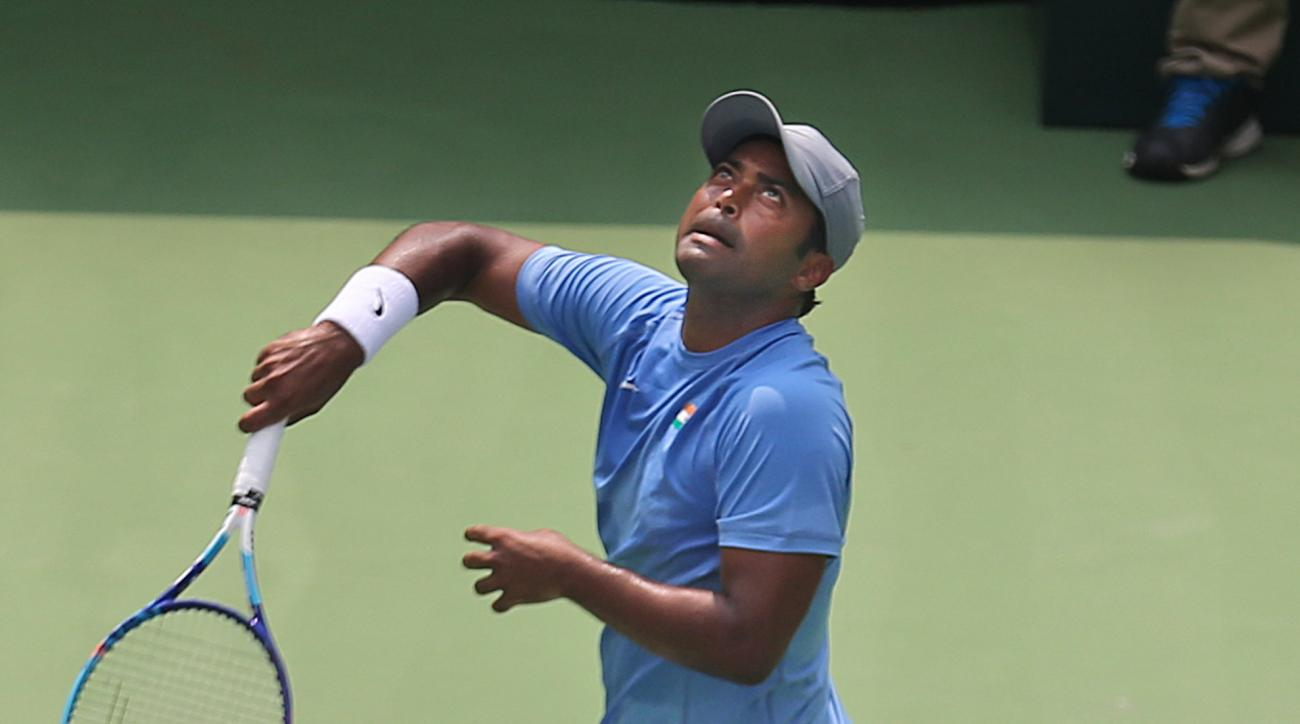 India's Leander Paes looks at the ball after playing a shot during the doubles match of the Davis Cup World Group play-off tie against Czech Republic's Adam Pavlasek and Radek Stepanek in New Delhi, India, Saturday, Sept. 19, 2015. The Czech Republic defe