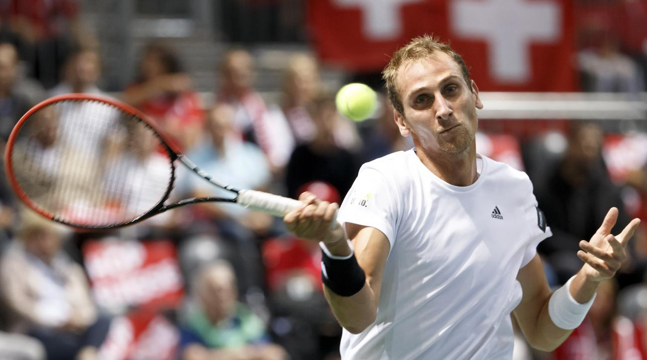 Thiemo De Bakker, of The Netherlands, plays a shot to Roger Federer, of Switzerland, during the third  single match of the Davis Cup World Group Play-off round match between Switzerland and Netherlands  in Geneva, Switzerland, Sunday,  Sept.  20, 2015.  (