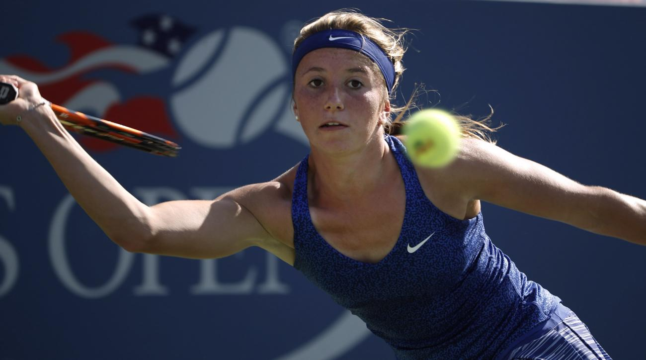 Annika Beck, of Germany, returns a shot against Sloane Stephens, of the United States, during the opening round of the 2014 U.S. Open tennis tournament, Monday, Aug. 25, 2014, in New York. (AP Photo/Kathy Willens)