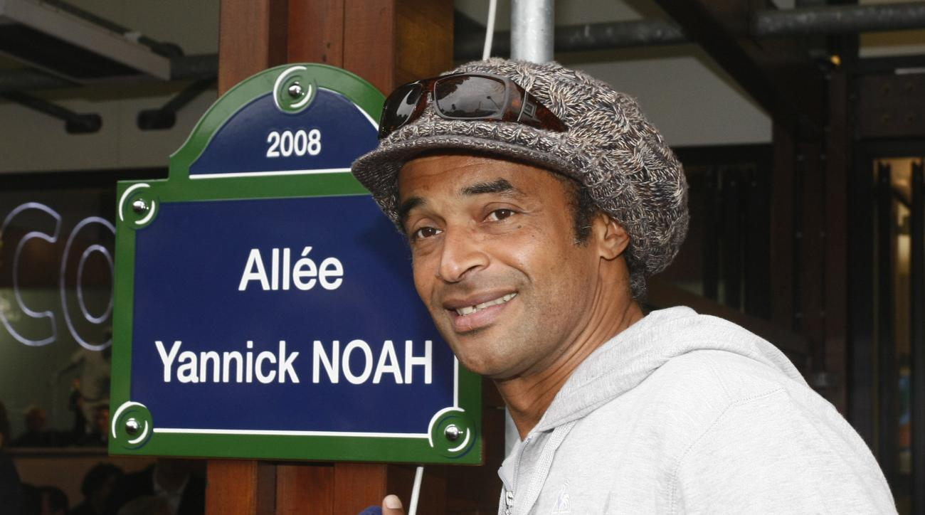 FILE - In this May 27, 2008 file photo, former tennis ace Yannick Noah, of France, winner of the French Open tennis tournament in 1983, inaugurates a walking path which bears his name, at the Roland Garros stadium in Paris. Yannick Noah, the last Frenchma