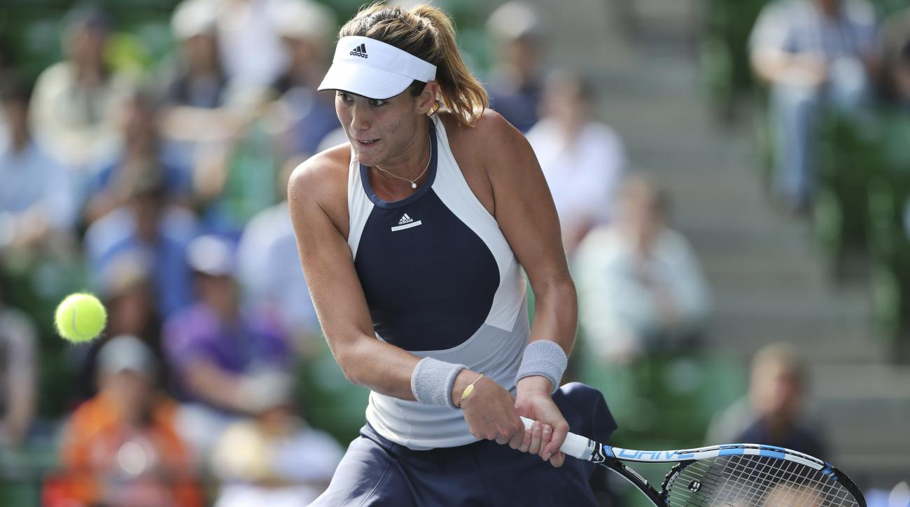 Garbine Muguruza of Spain returns a shot against Barbora Strycova of Czech Republic during the second round of the Pan Pacific Open women's tennis tournament in Tokyo, Wednesday, Sept. 23, 2015. (AP Photo/Koji Ueda)
