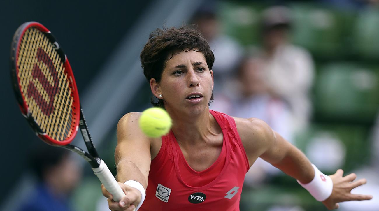 Carla Suarez Navarro, of Spain, returns a ball against Dominika Cibulkova of Slovakia during the second round of the Pan Pacific Open women's tennis tournament in Tokyo, Thursday, Sept. 24, 2015.(AP Photo/Eugene Hoshiko)