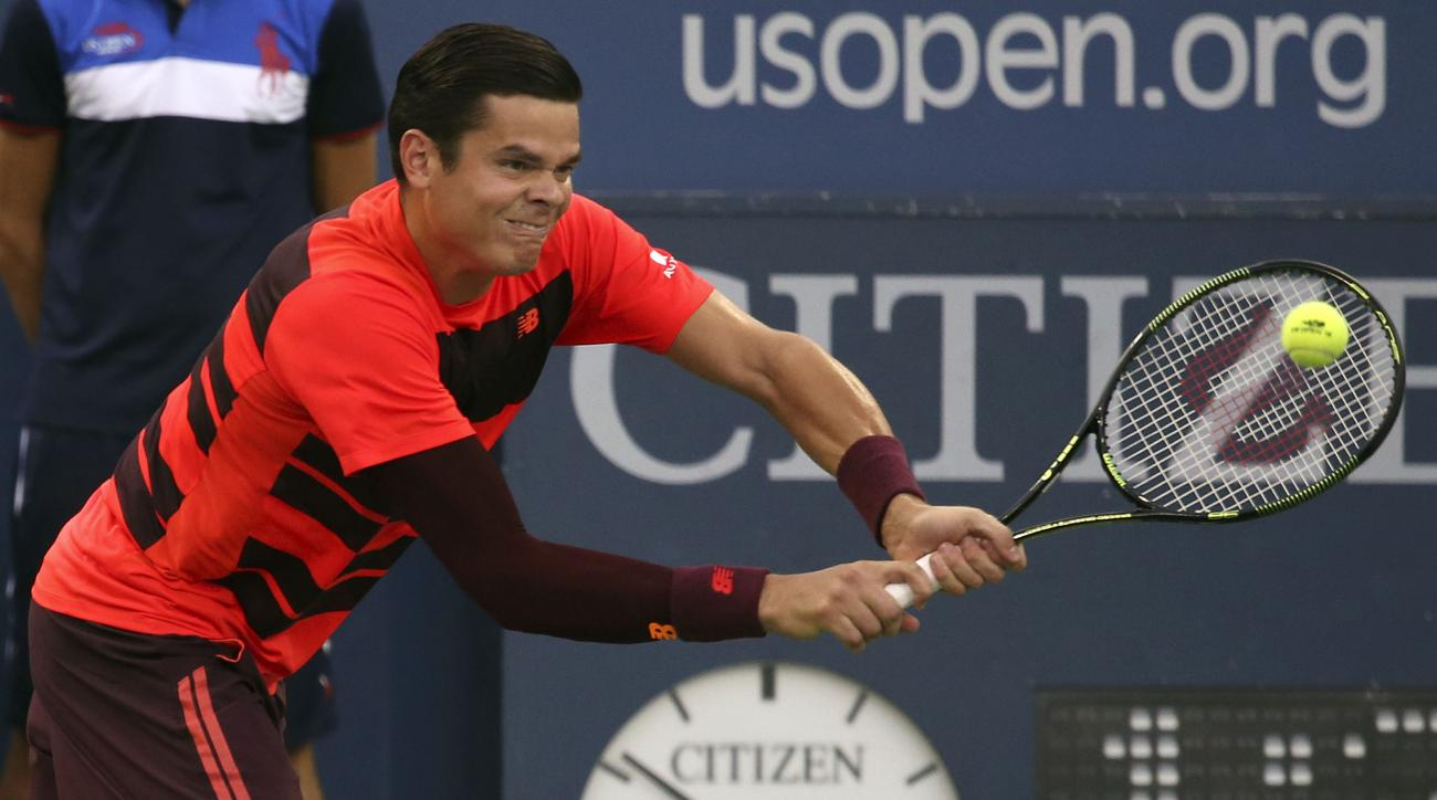 Milos Raonic, of Canada, hits a return shot to Feliciano Lopez, of Spain, during the third round of the U.S. Open tennis tournament, Friday, Sept. 4, 2015, in New York. (AP Photo/Adam Hunger)