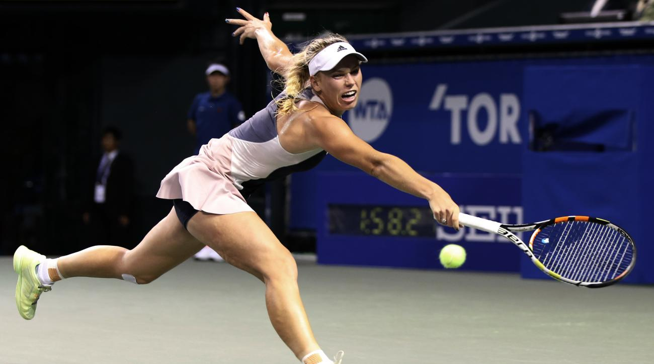 Caroline Wozniacki of Denmark returns a ball against Angelique Kerber of Germany during a quarterfinal match at the Pan Pacific Open women's tennis tournament in Tokyo, Friday, Sept. 25, 2015. (AP Photo/Eugene Hoshiko)