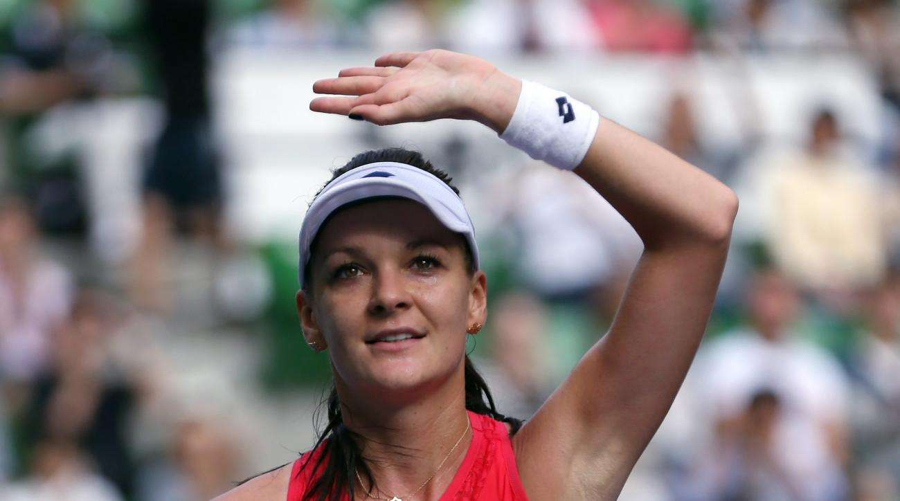 Agnieszka Radwanska of Poland acknowledges the crowd after defeating Dominika Cibulkova of Slovakia during a semifinal match at the Pan Pacific Open women's tennis tournament in Tokyo, Saturday, Sept. 26, 2015. (AP Photo/Eugene Hoshiko)