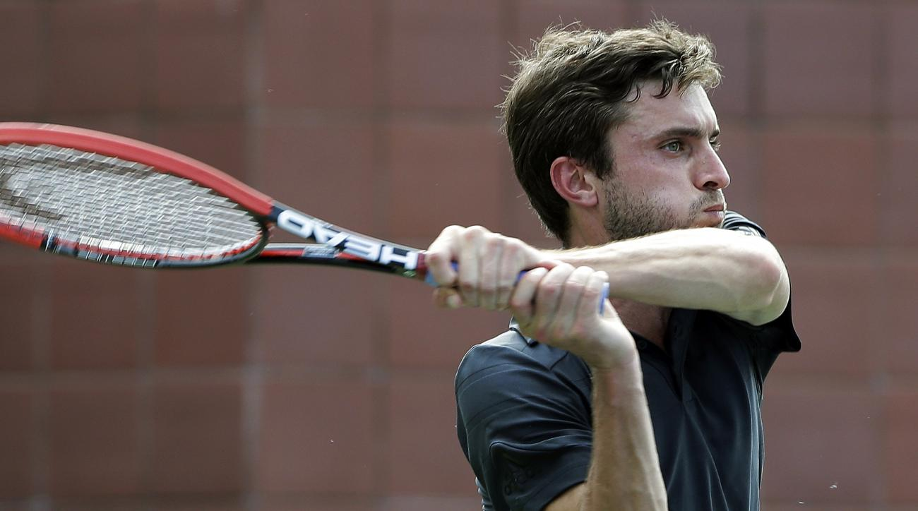 Gilles Simon, of France, returns to Donald Young, of the United States, during the first round of the U.S. Open tennis tournament, Tuesday, Sept. 1, 2015, in New York. (AP Photo/Frank Franklin II)