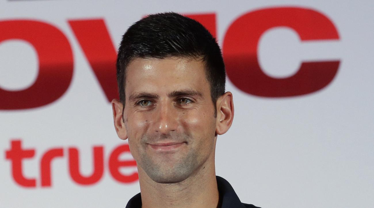 """Tennis player Novak Djokovic of Serbia gives a Thai traditional """"wai"""" after a press conference for his exhibition match against Spain's Rafael Nadal in Bangkok, Thailand, Thursday, Oct. 1, 2015. The event will be held on Oct 2 .(AP Photo/Sakchai Lalit)"""